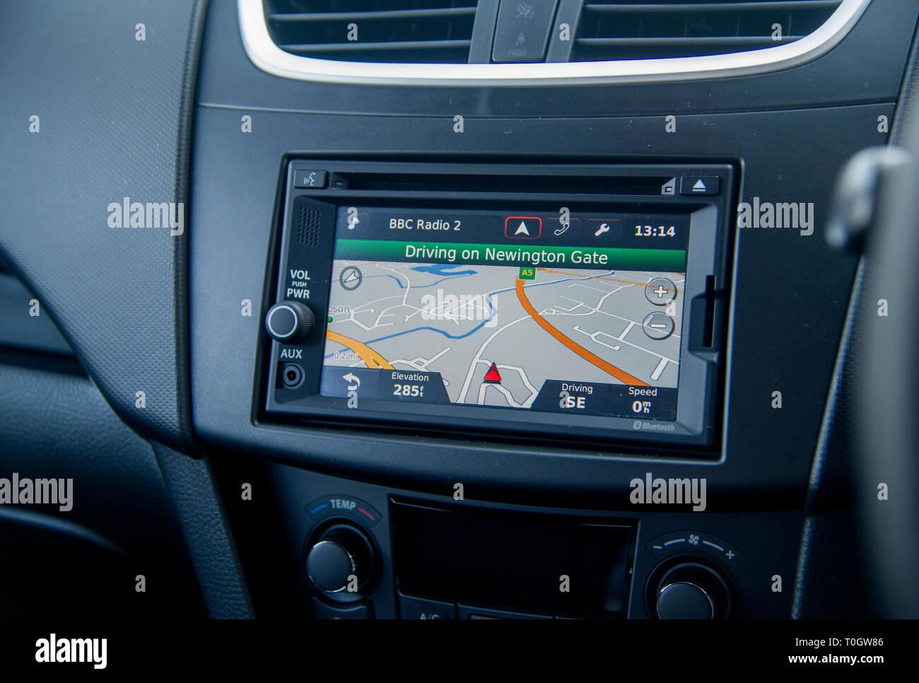 Sat nav screen in a car dashboard, double din size headunit - Stock Image