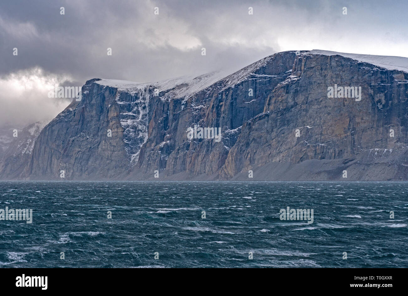 Dramatic Cliffs Above Storm Tossed Seas in the Sam Ford Fjord on Baffin Island in Nunavut, Canada - Stock Image