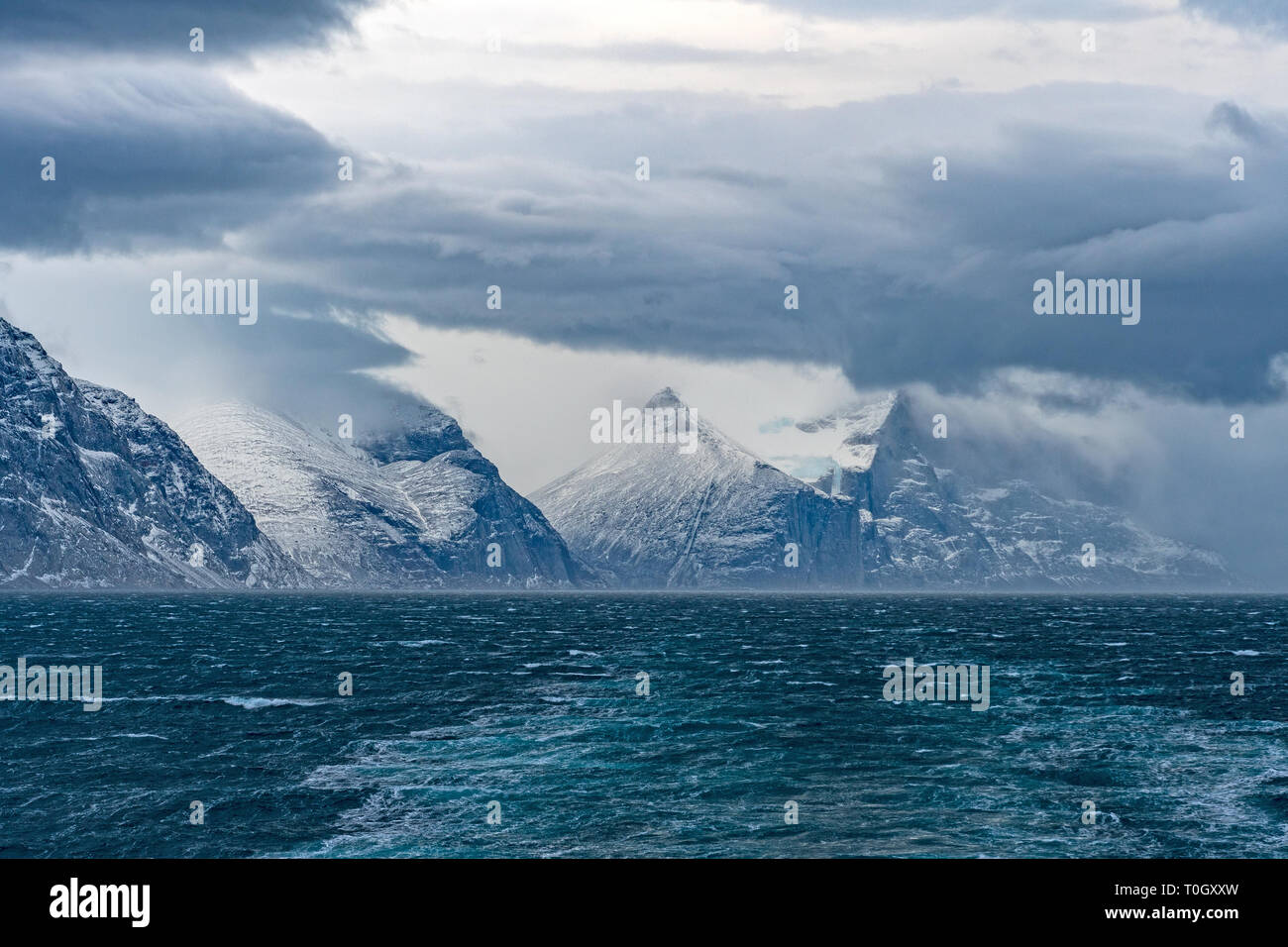 Storm Clouds above an Ocean Fjord in the Sam Ford Fjord in Baffin Island in Nunavut, Canada - Stock Image