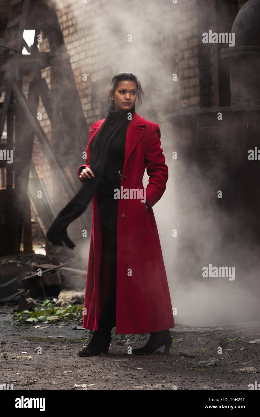 Woman in a red raincoat steampunk - Stock Image