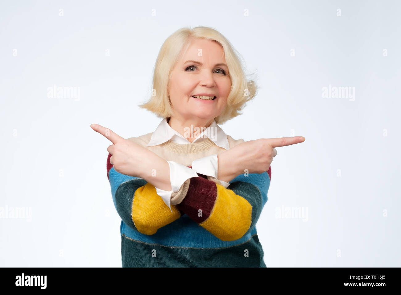Senior blond cute woman decide between two options - Stock Image