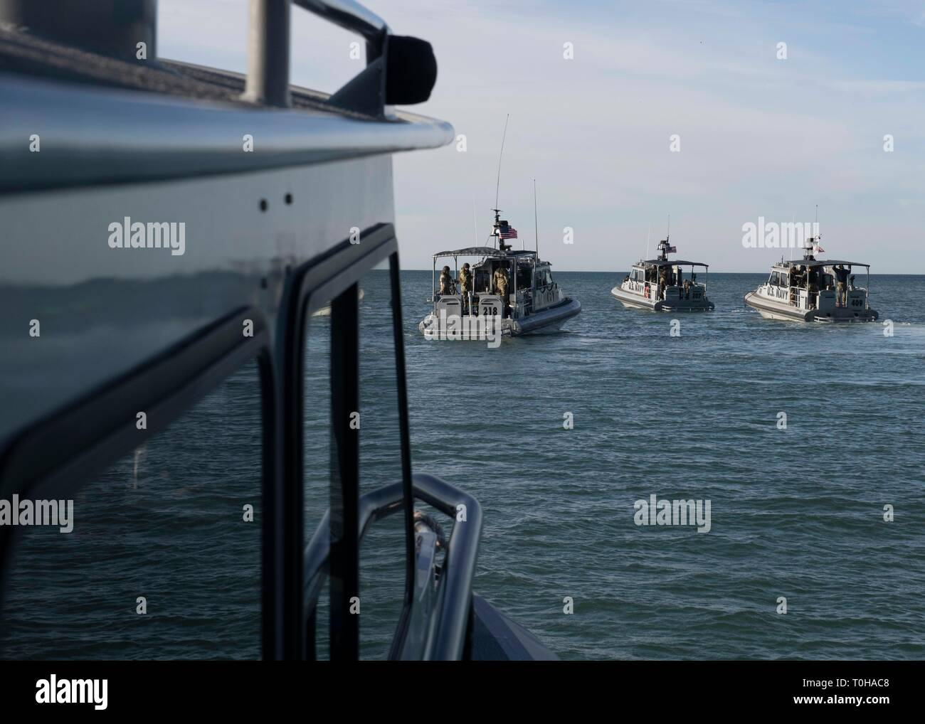 190315-N-RU084-1001 OXNARD, CALIF. (Mar. 15, 2019) – Seabees from Underwater Construction Team 2 (UCT-2) and Sailors from Coastal Riverine Squadrons (CRS) 3 and 11 transit out to Santa Rosa Island in 34-foot patrol boats, California to perform hydrographic survey and pier damage assessment training in support of Exercise Pacific Blitz 2019 (PacBlitz19). This training is the first time UCT-2 has worked with CRS and tests their ability to map areas for small craft landing enabling continued support to Navy and Marine Corps operations. PacBlitz19 provides realistic, relevant training necessary fo Stock Photo