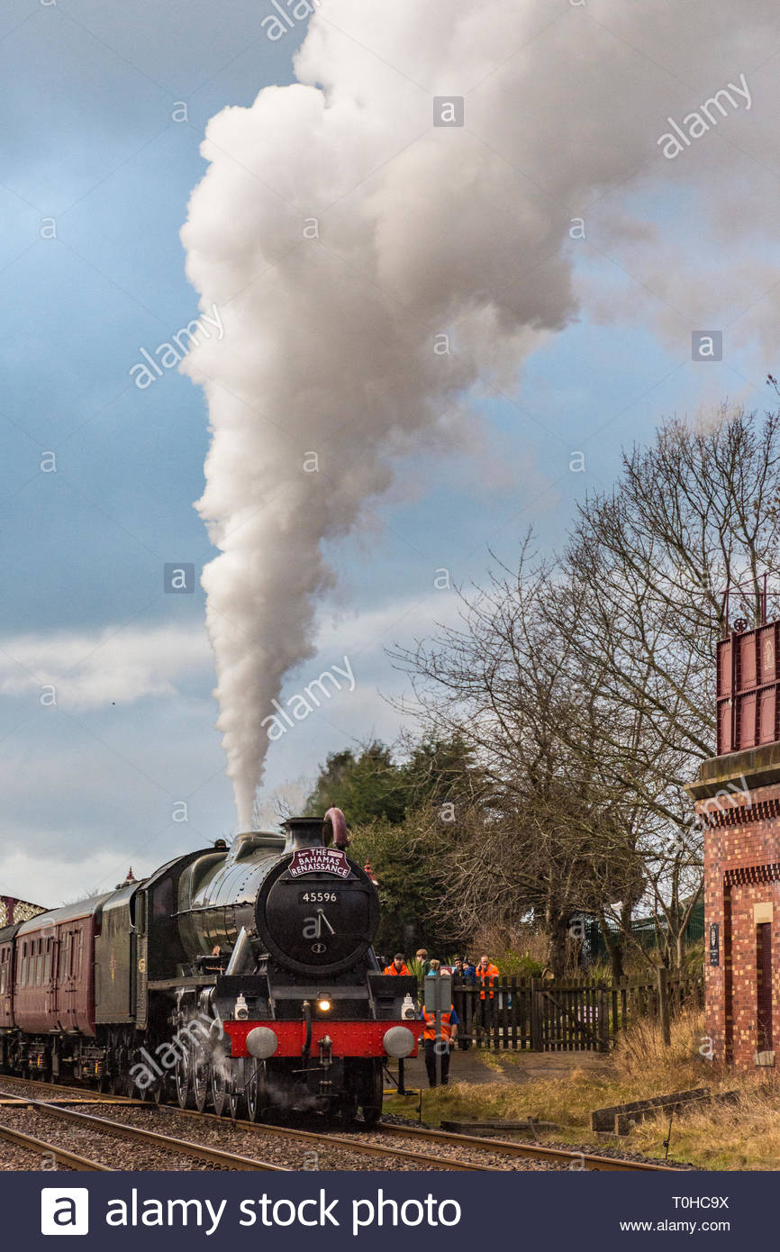 The Bahamas steam locomotive stops for water at Appleby in Westmorland on its journey south over the Settle and Carlisle Railway, 9 February 2019 - Stock Image