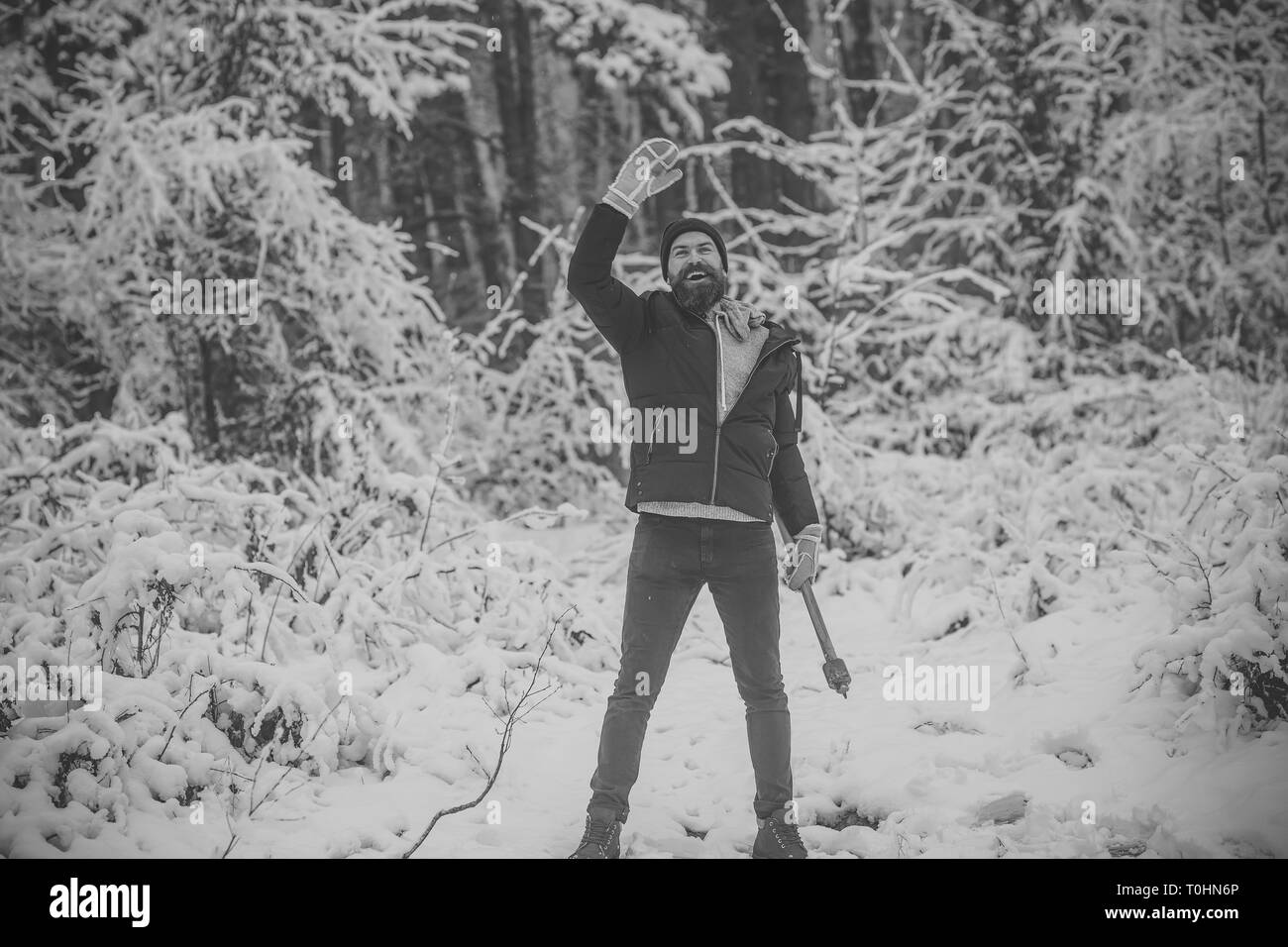 Man lumberjack in thermal jacket with ax. - Stock Image