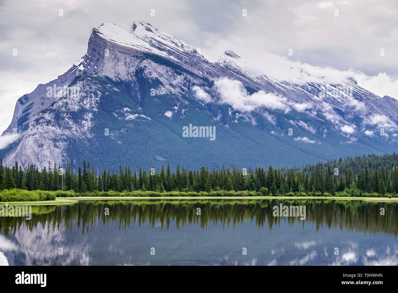 The Mountains and Vermillion Lake at Banff National Park in Alberta Canada from the  road that runs alongside the park Stock Photo
