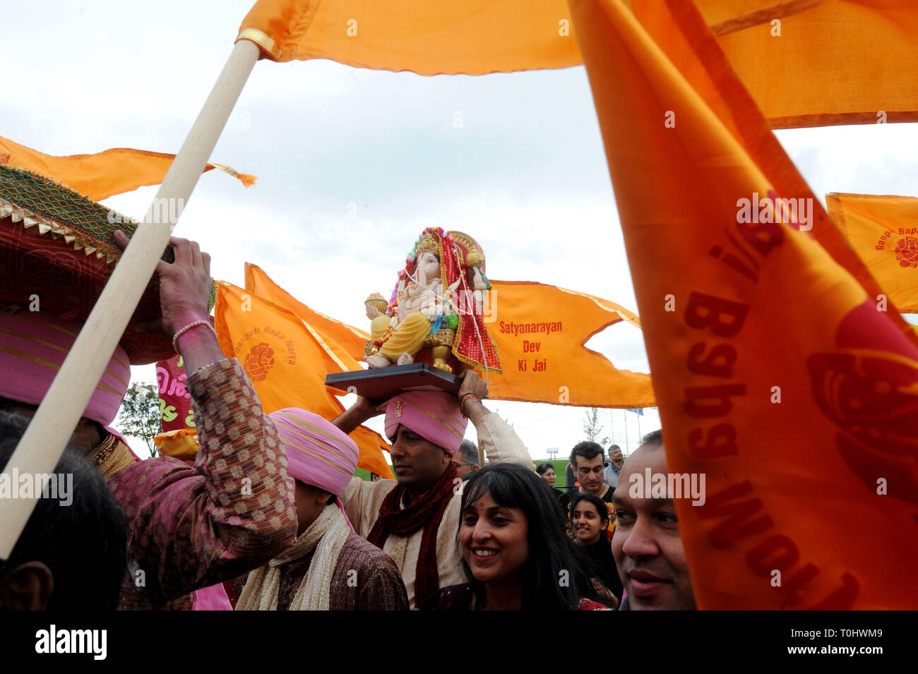 East beach, Shoeburyness Essex. Ganesha festival. Hindu worshippers processing with statue of the Elephant God Ganesh.   Picture Steve O'Connell   19 /09/2010 - Stock Image