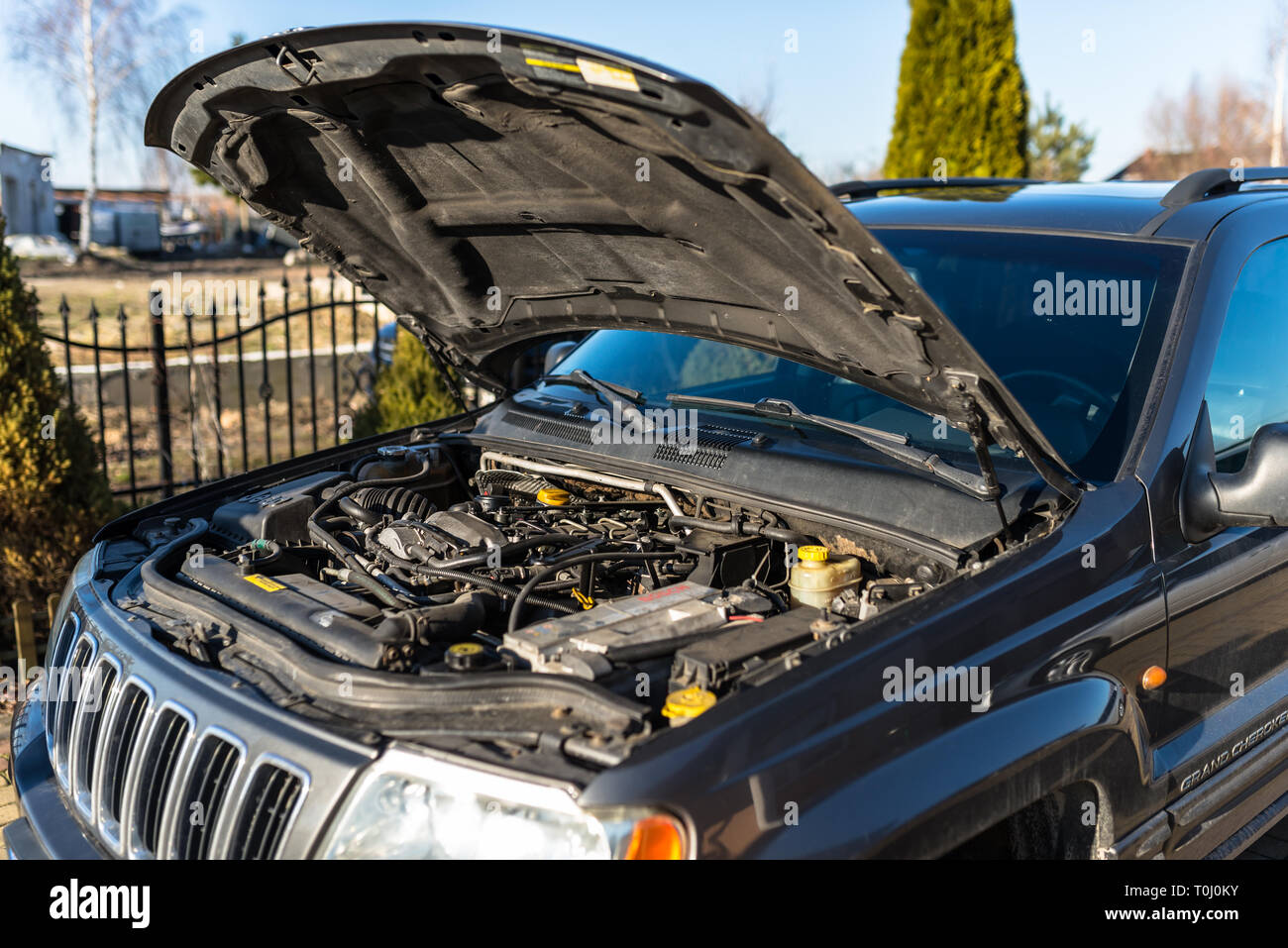 Torun, Poland - February 16, 2019. The engine compartment of the Jeep Grand Cherokee WJ produced in 2002 with a diesel engine with an automatic transm - Stock Image