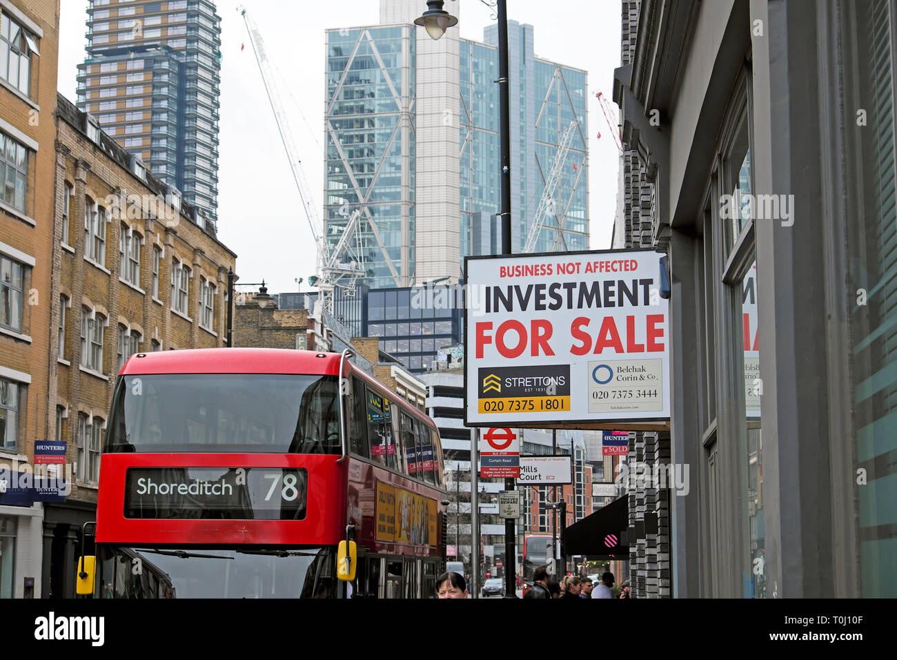 The 78 Shoreditch bus and property for sale investment sign in a street in East London UK  KATHY DEWITT Stock Photo