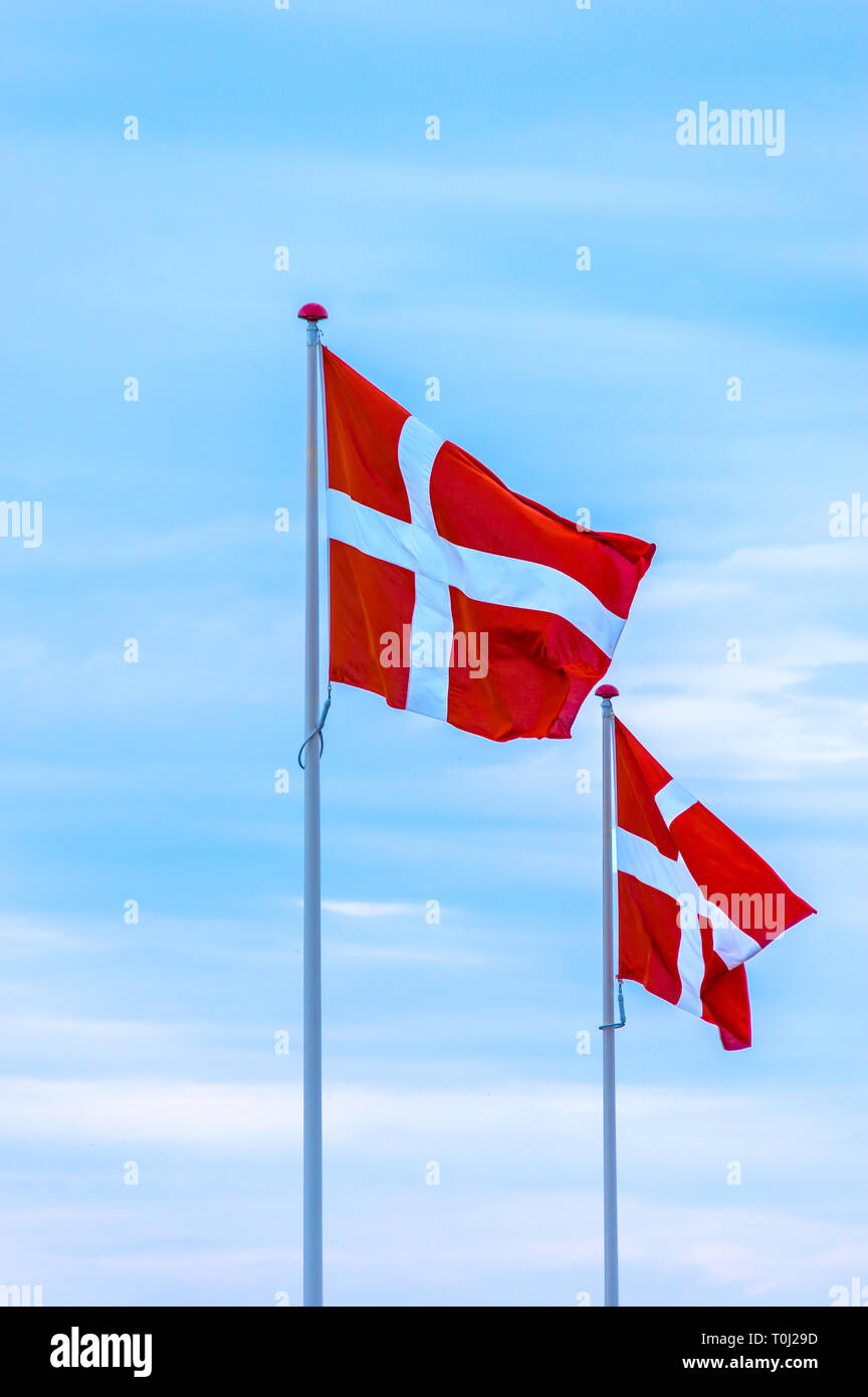 Flags of the Kingdom of Denmark waving in the wind. - Stock Image