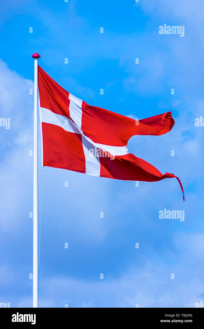 Flag of the Kingdom of Denmark waving in the wind. - Stock Image