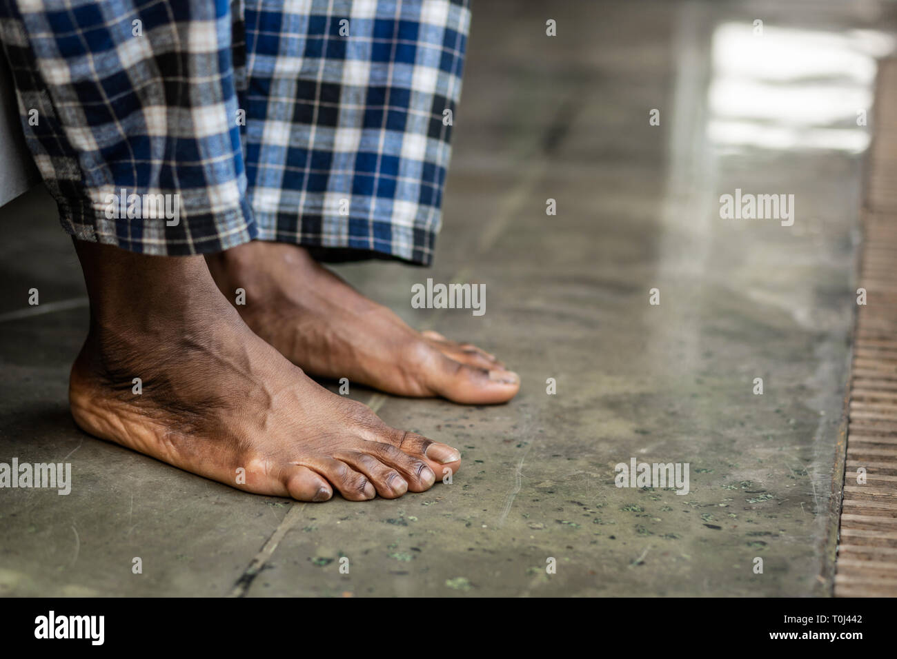 Feet of a nice African American man touching the floor Stock Photo