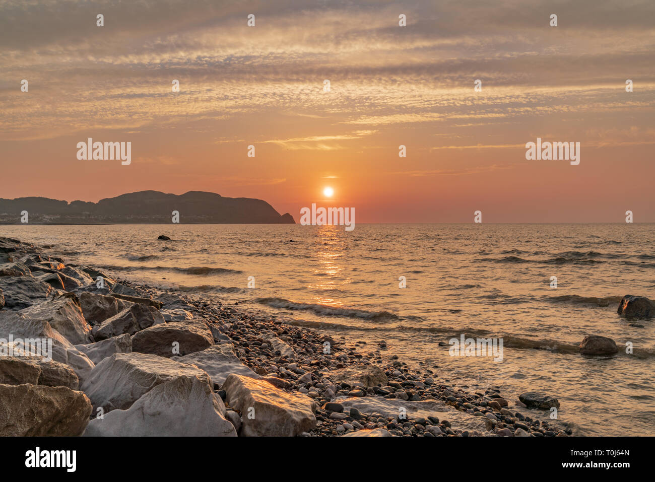 Sunset over the Welsh coast in Rhos-on-Sea, Conwy, Wales, UK Stock Photo