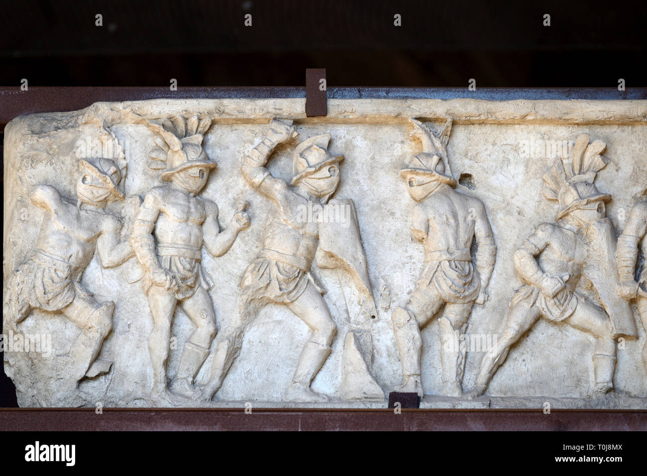 Carved Marble Frieze of Roman Gladiators from the Necropolis in Pompeii (on Display in the Colosseum Rome) - Stock Image