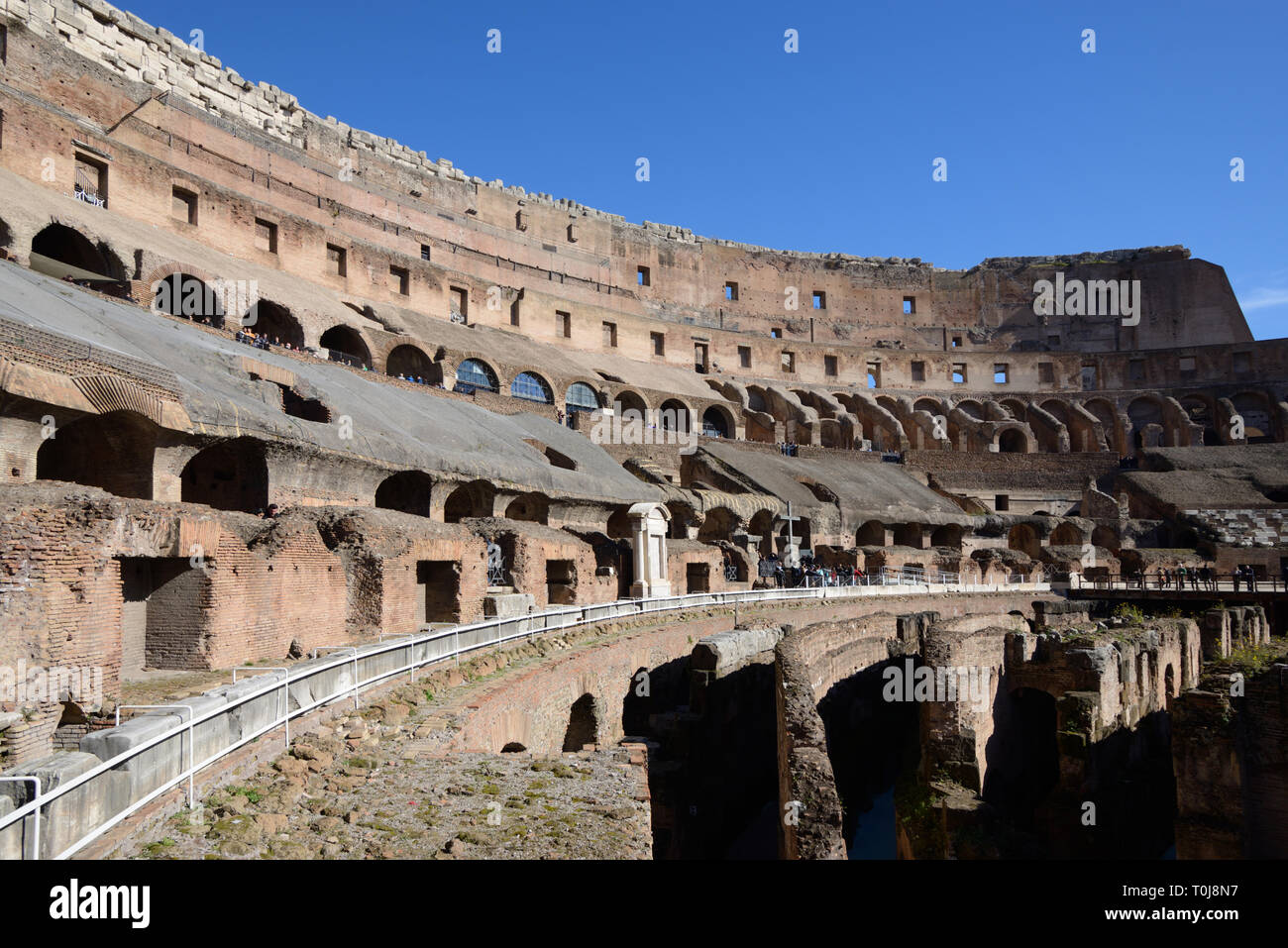 Interior with Seating of the Colosseum, or Coliseum, or Flavian Amphitheatre (70-80AD) Roman Monument, Rome, Italy - Stock Image