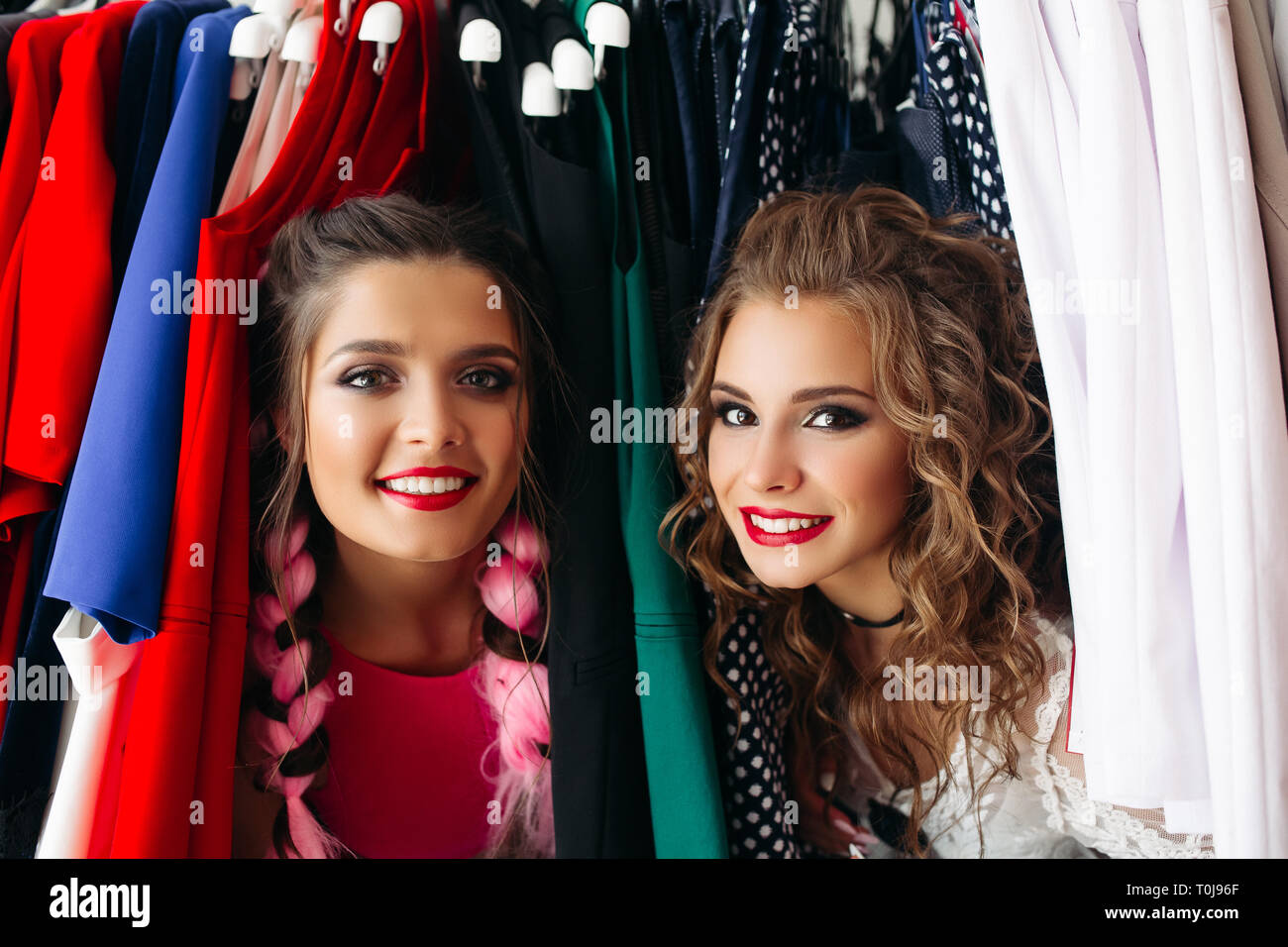 0a45133877edd Happy fashionable girls having fun together,spending time at store. - Stock  Image