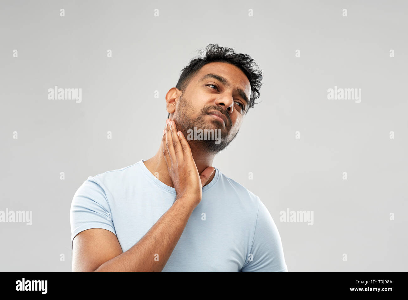 indian man suffering from sore glands or tonsils - Stock Image