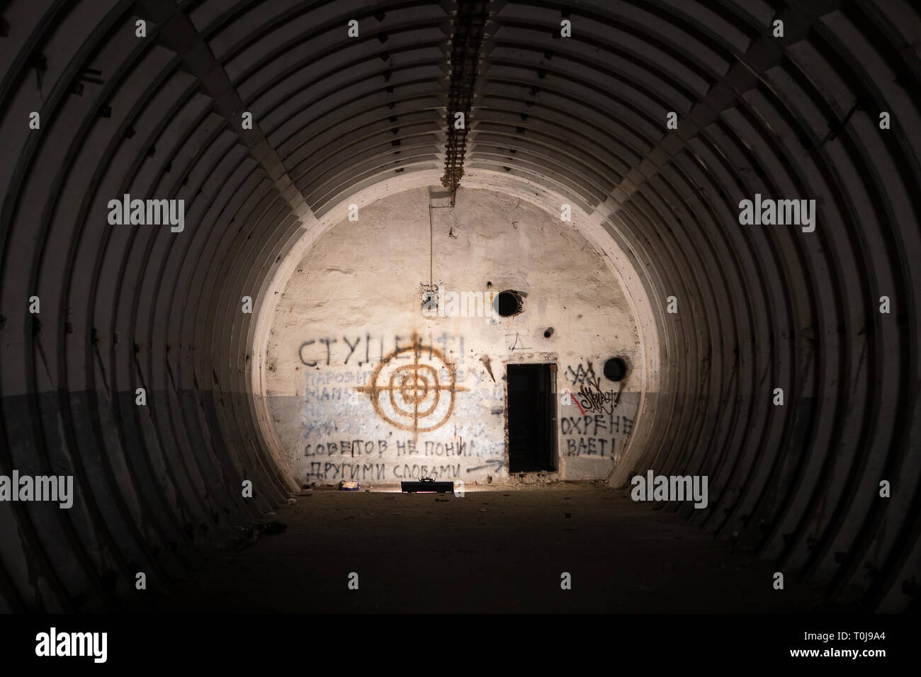 Abandoned ballistic missile bunker with graffiti and painted target, legacy of the Cold War - Stock Image