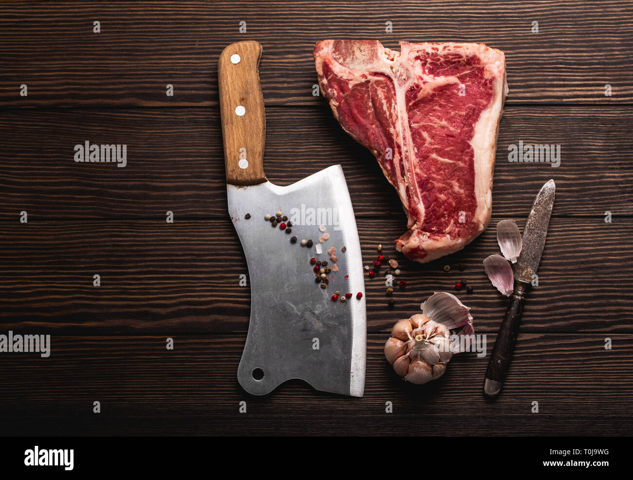 T-bone and meat cleaver - Stock Image