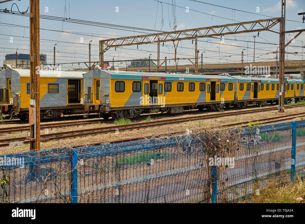 Metrorail train in yard station, in the suburbs of Joburg, South Africa - January 17, 2019 Stock Photo