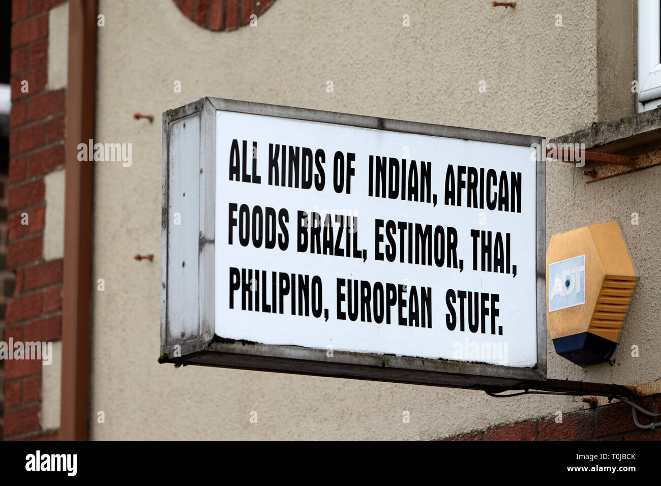 sign for shop selling imported foods for immigrants dungannon county tyrone northern ireland uk - Stock Image