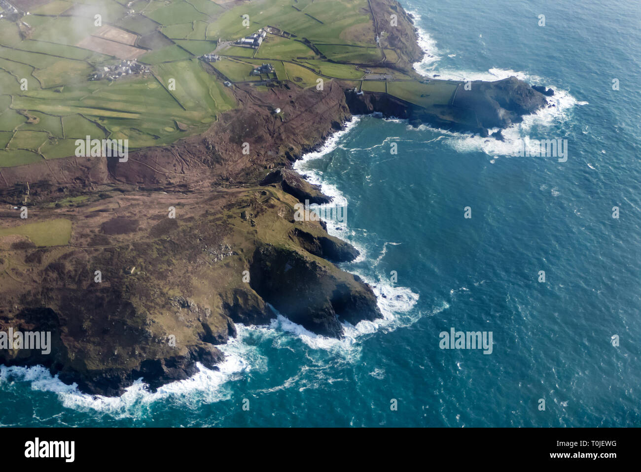 In the air over Cape Cornwall, Cornwall: Newquay to St. Mary's Skybus, DHC-6 Twin Otter - Stock Image