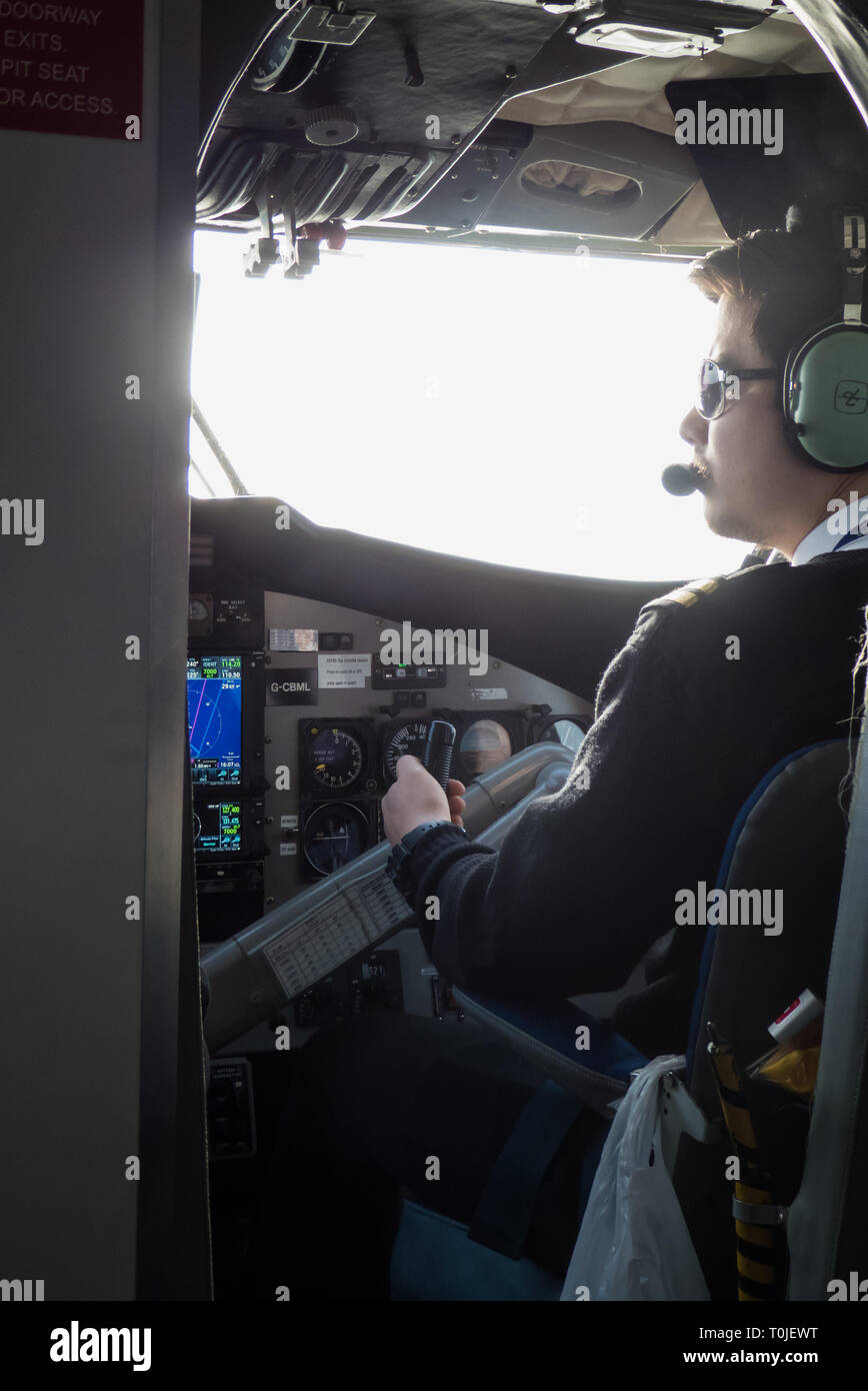 Pilot at work, Newquay to St. Mary's Skybus, DHC-6 Twin Otter - Stock Image