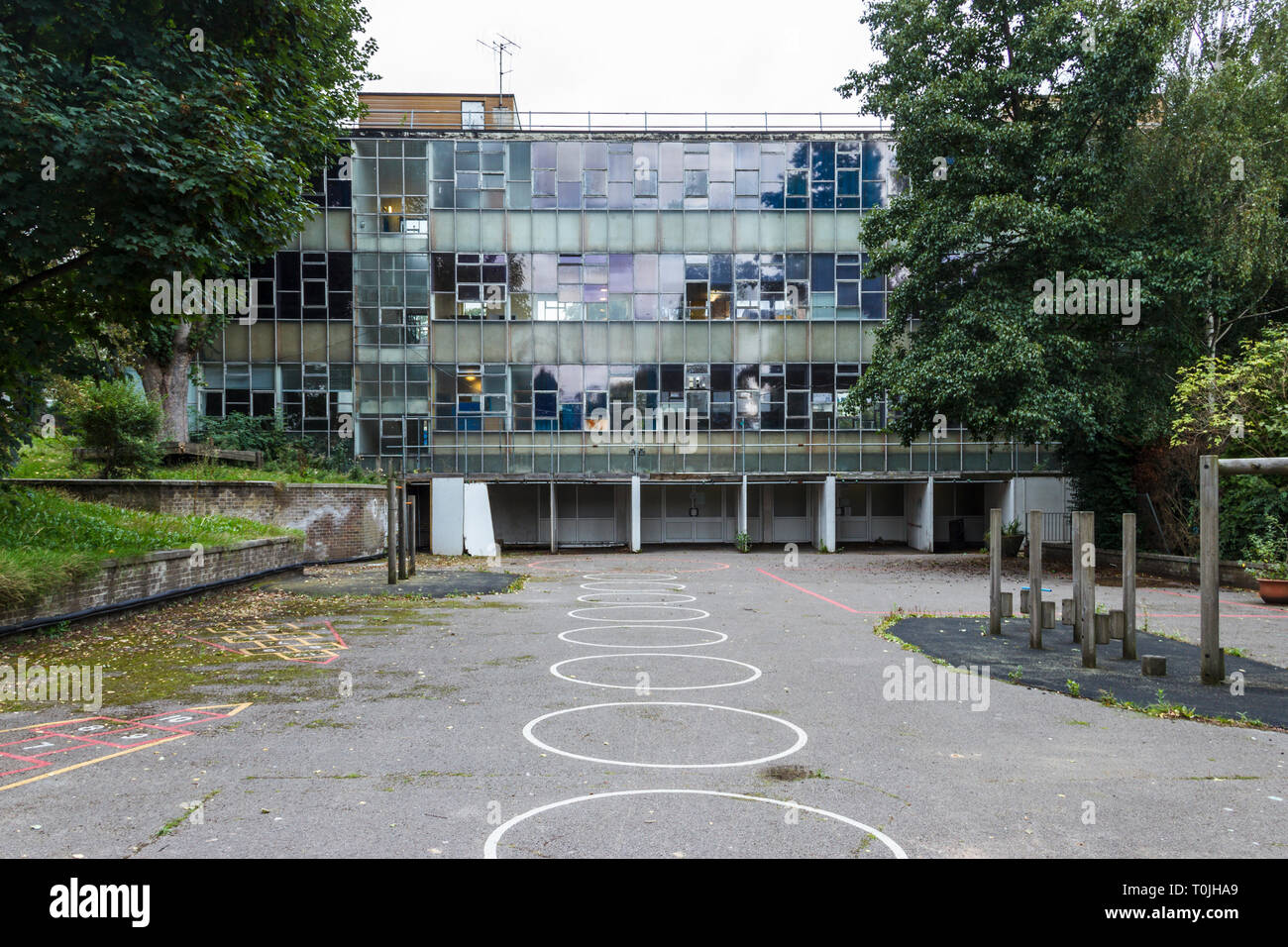 The playground and main building of the empty Ashmount Primary School, before its demolition and rebuilding as Whitehall Park School, North London, UK - Stock Image