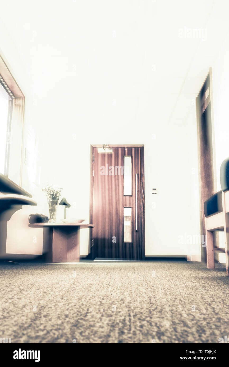 Low angle zoom-blurred image of an empty waiting room or reception area, as in a doctor's surgery or clinic Stock Photo