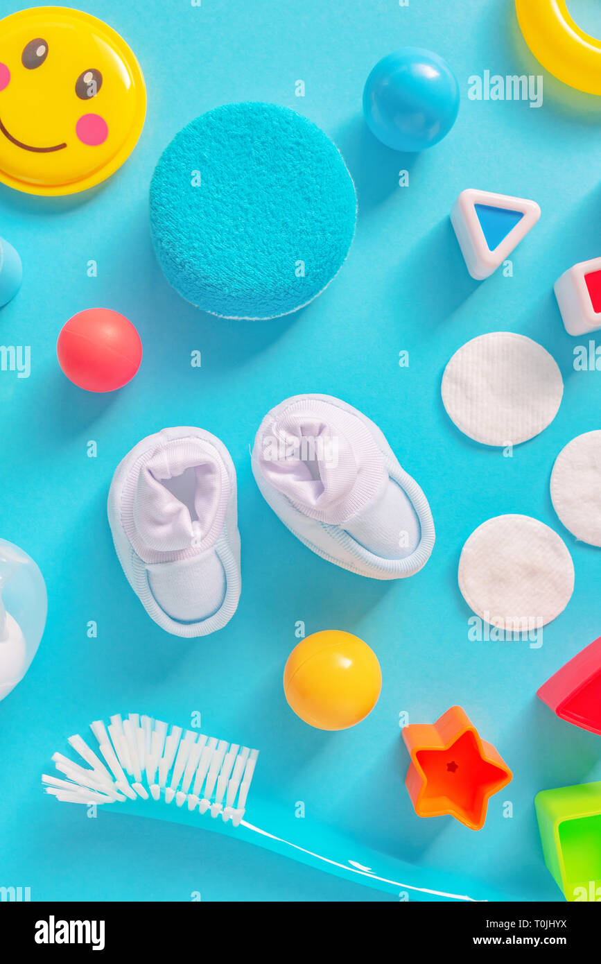 3b354d01a1a60 Baby boy personal accessories, top view on pastel background. Newborn  infant care products and toys in flat lay arrangement.