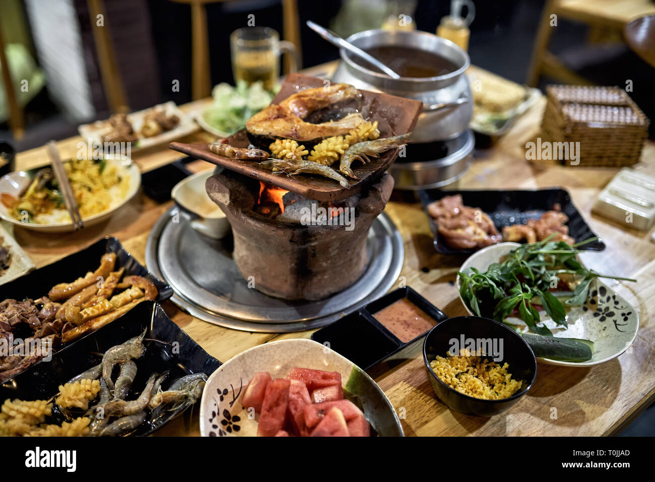 Traditional vietnamese hot spot restaurant with varied food - Stock Image