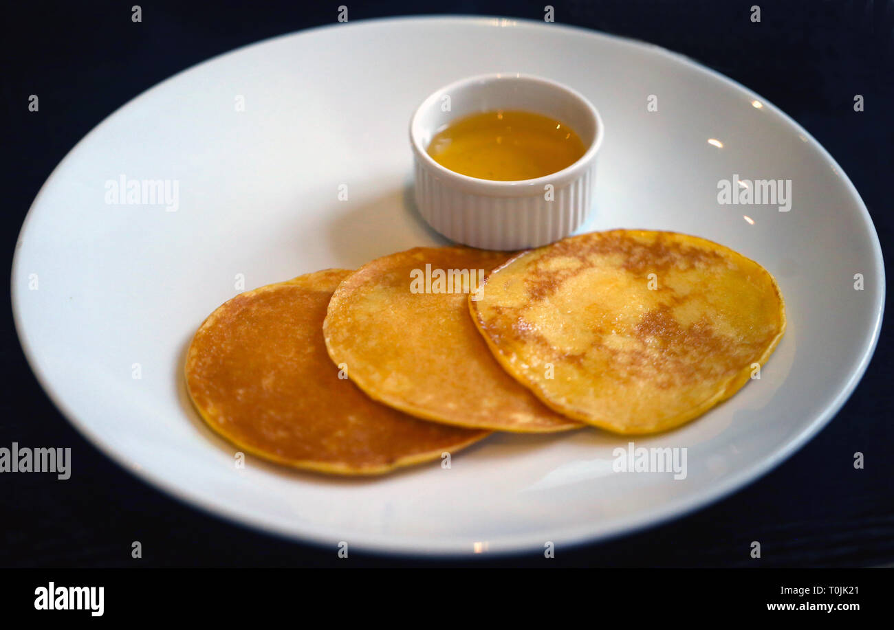 Big delicious pancake on a black background take a close-up picture - Stock Image