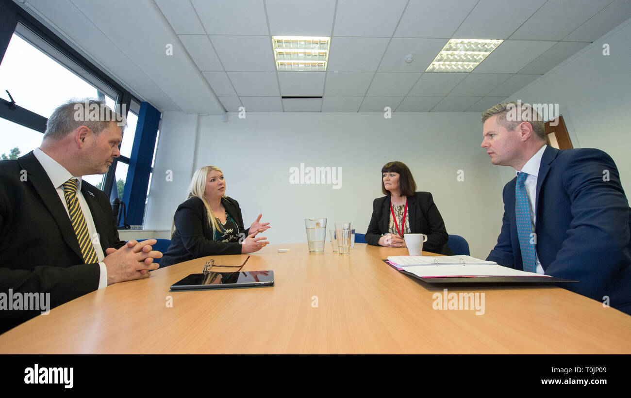 Larbert, Falkirk, UK. 20th Mar, 2019. Pictured: (left-right) George Falconer;Karen Motherwell; Maureen Maxwell; Derek Mackay. Derek Mackay, Cabinet Secretary for Finance, Economy and Fair Work visits a social enterprise to comment on the latest GDP statistics and hear about their work to support adults with different disabilities into work. There was a board room discussion followed by a factory floor tour showing the various products currently being manufactured. Credit: Colin Fisher/Alamy Live News - Stock Image