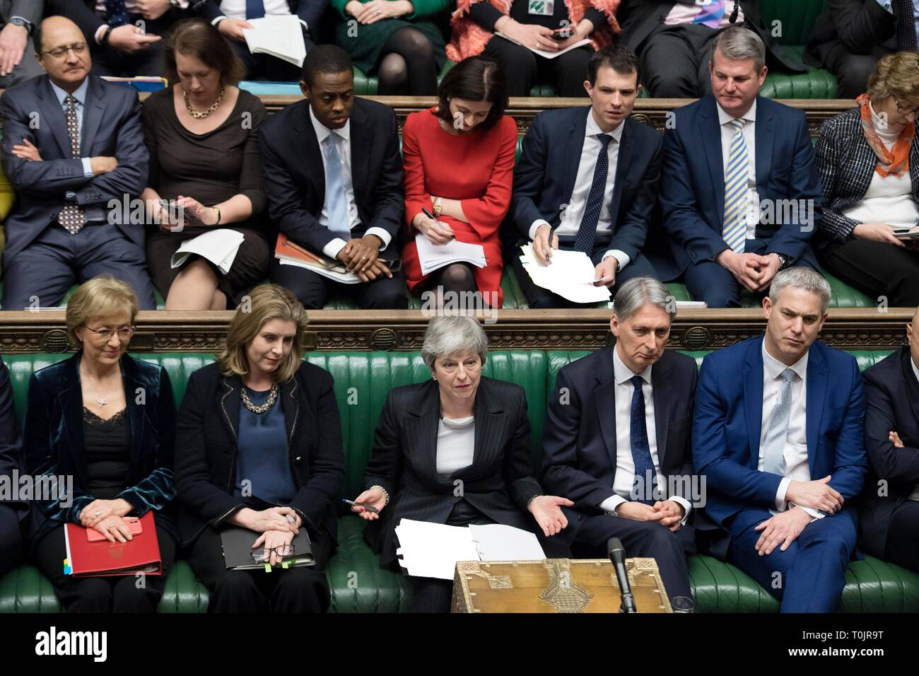 London, UK. 20th Mar, 2019. British Prime Minister Theresa May (C, Front) attends the Prime Minister's Question Time in the House of Commons in London, Britain, on March 20, 2019. Theresa May confirmed Wednesday she has written to the European Union seeking to delay Britain's departure from the bloc until June 30. Credit: UK Parliament/Jessica Taylor/Xinhua/Alamy Live News Stock Photo
