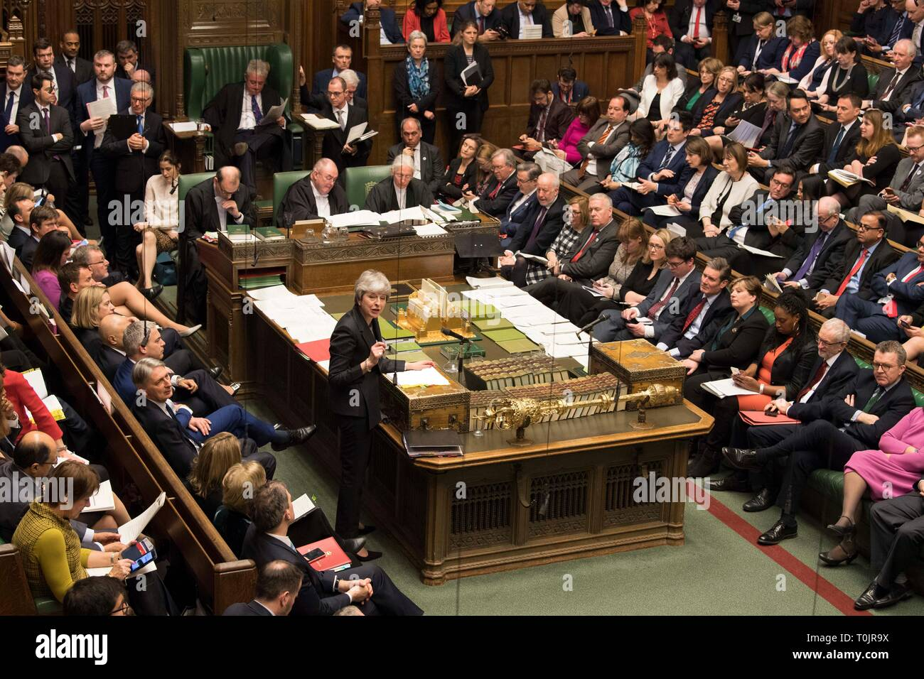 London, UK. 20th Mar, 2019. British Prime Minister Theresa May (C) speaks during the Prime Minister's Question Time in the House of Commons in London, Britain, on March 20, 2019. Theresa May confirmed Wednesday she has written to the European Union seeking to delay Britain's departure from the bloc until June 30. Credit: UK Parliament/Mark Duffy/Xinhua/Alamy Live News - Stock Image