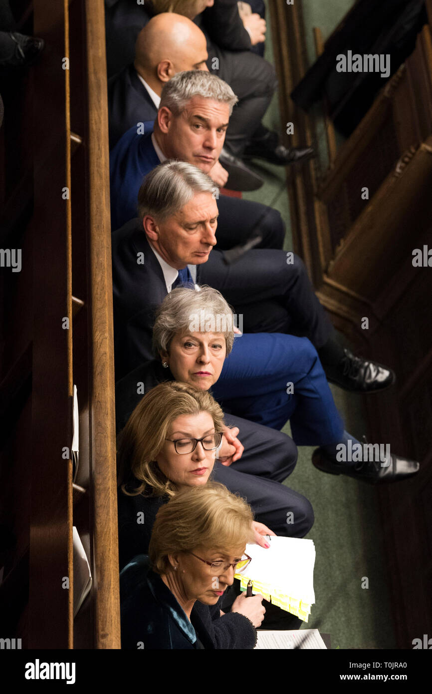 London, UK. 20th Mar, 2019. British Prime Minister Theresa May (3rd from Bottom) attends the Prime Minister's Question Time in the House of Commons in London, Britain, on March 20, 2019. Theresa May confirmed Wednesday she has written to the European Union seeking to delay Britain's departure from the bloc until June 30. Credit: UK Parliament/Mark Duffy/Xinhua/Alamy Live News - Stock Image