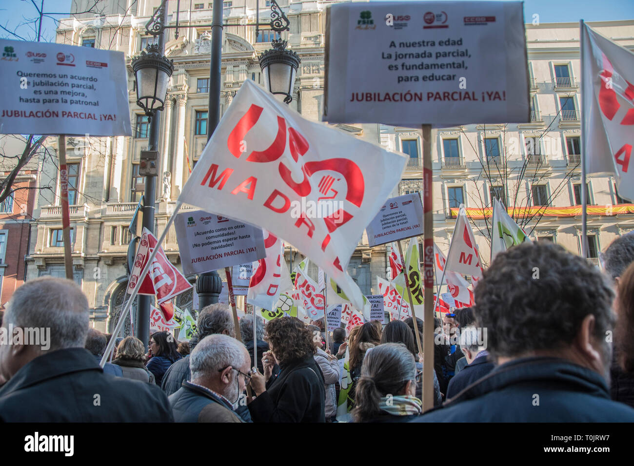 Madrid, Spain. 20th Mar 2019. Teachers with a placard with the motto. At our age, part-time work is essential to educate.  The Ministry of Education and Research is the community of Madrid refuses to sign a partial retirement agreement for teachers. Credit: Alberto Sibaja Ramírez/Alamy Live News Stock Photo