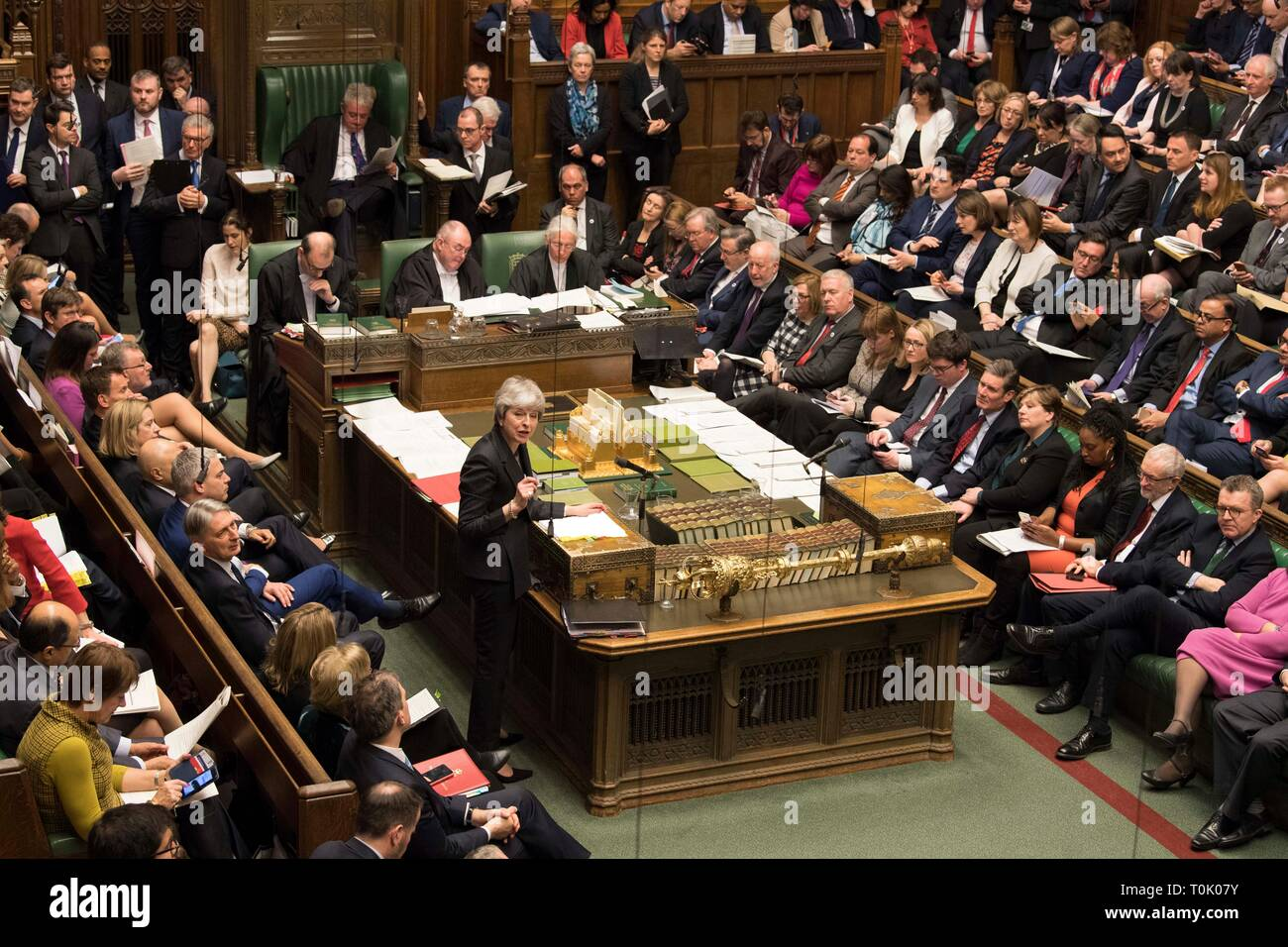 Beijing, Britain. 20th Mar, 2019. British Prime Minister Theresa May (C) speaks during the Prime Minister's Question Time in the House of Commons in London, Britain, on March 20, 2019. Theresa May confirmed Wednesday she has written to the European Union seeking to delay Britain's departure from the bloc until June 30. Credit: UK Parliament/Mark Duffy/Xinhua/Alamy Live News - Stock Image