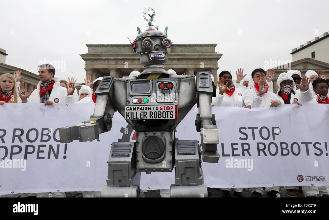 Berlin, Germany. 21st Mar, 2019. People take part in a campaign of the association 'Facing Finance' to ban killer robots in front of the Brandenburg Gate. Credit: Wolfgang Kumm/dpa/Alamy Live News - Stock Image