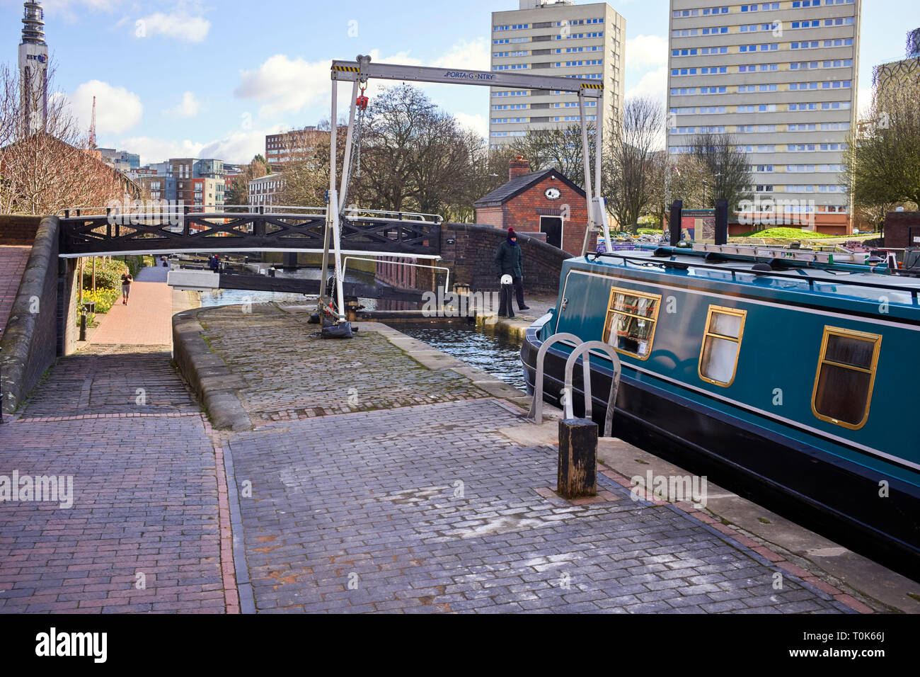 Narrowboat entering lock number one at Cambrian Wharf on a cold winter morning Stock Photo
