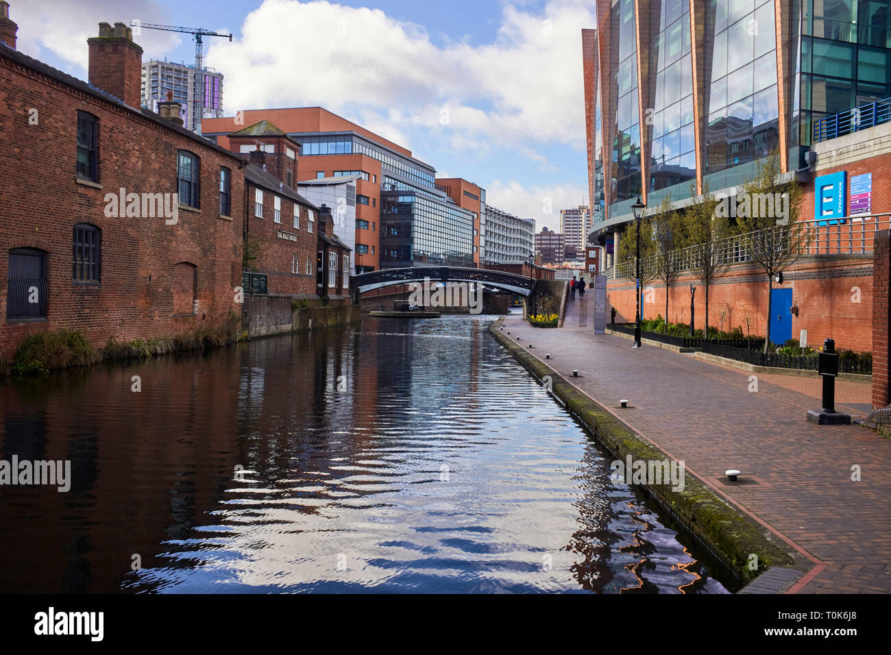 View toward Tyndall Bridge and the junction into Gas Street basin in Central Birminham canal network - Stock Image