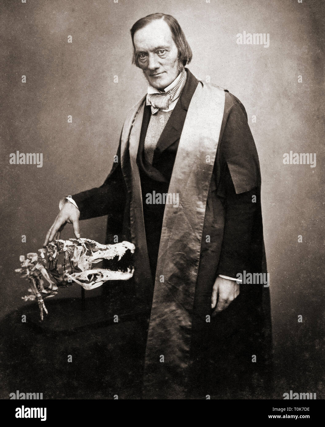 Sir Richard Owen, 1804-1892. English biologist, comparative anatomist and paleontologist.  Seen here with the skull of a crocodile. - Stock Image