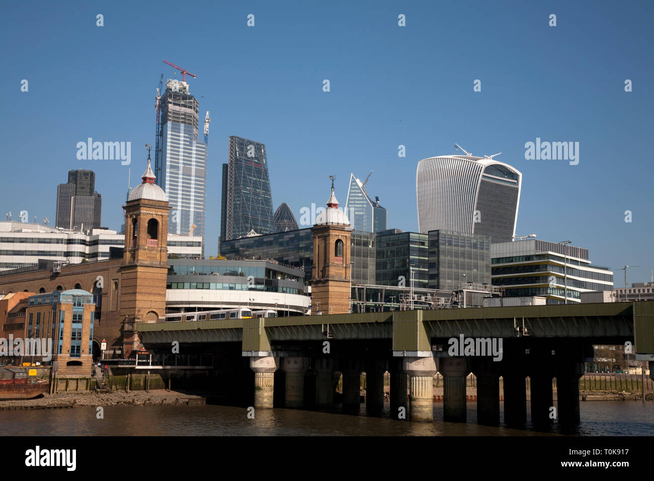 cannon street station and bridge and city of london skyscrapers london england - Stock Image