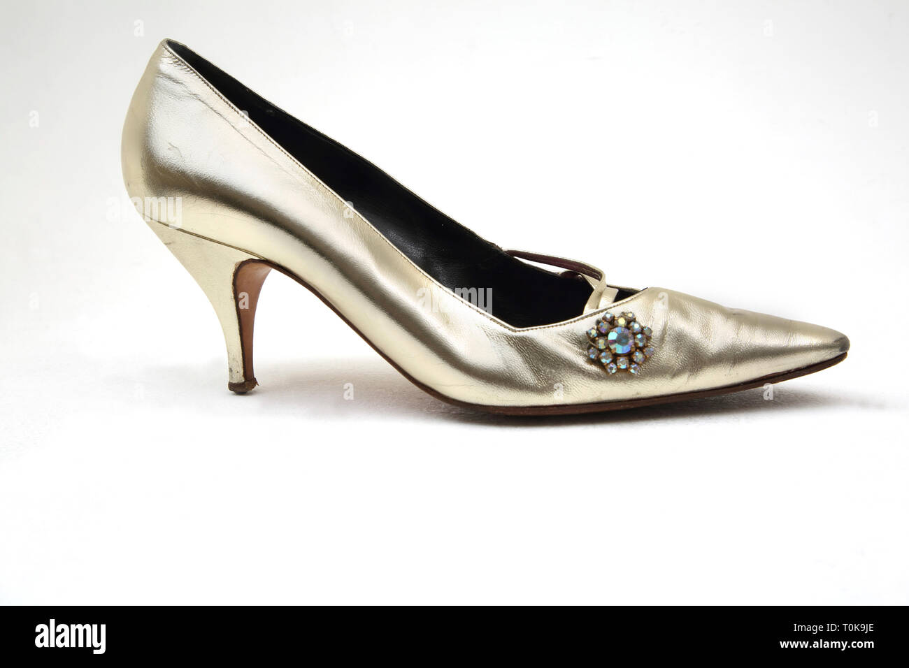 Gold Kitten Heel Shoe with Costume Jewel on the Side - Stock Image