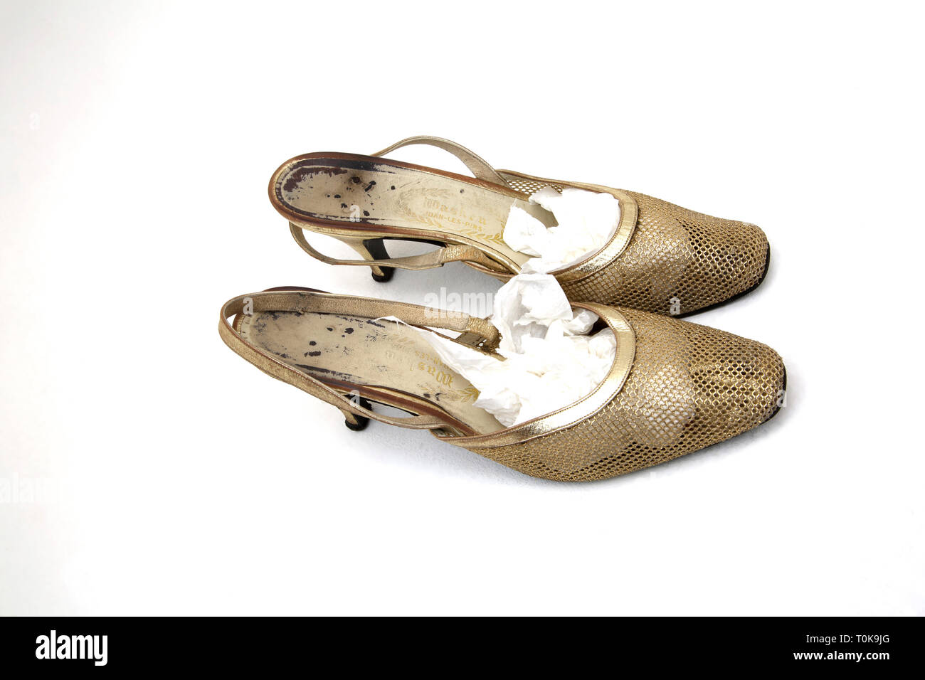 Worn 1950/60's Gold Mesh Sling Back Shoes - Stock Image