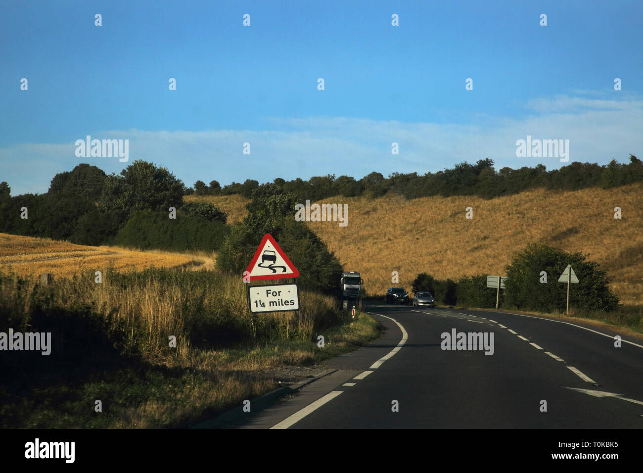 Cars on A303 on the way to Dorset slippery road ahead signEngland - Stock Image