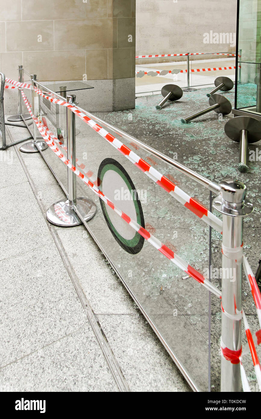 Hooliganism destruction with lot of broken glass - Stock Image