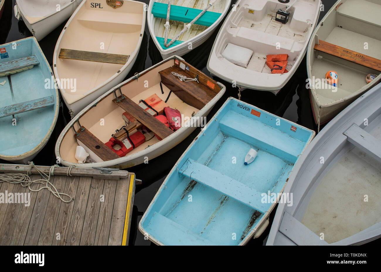 Busy during warm weather, Frisbee Wharf has a waiting list of boats wanting mooring for the summer. Small restaurant, ice cream shop at Pepperell Cove. - Stock Image