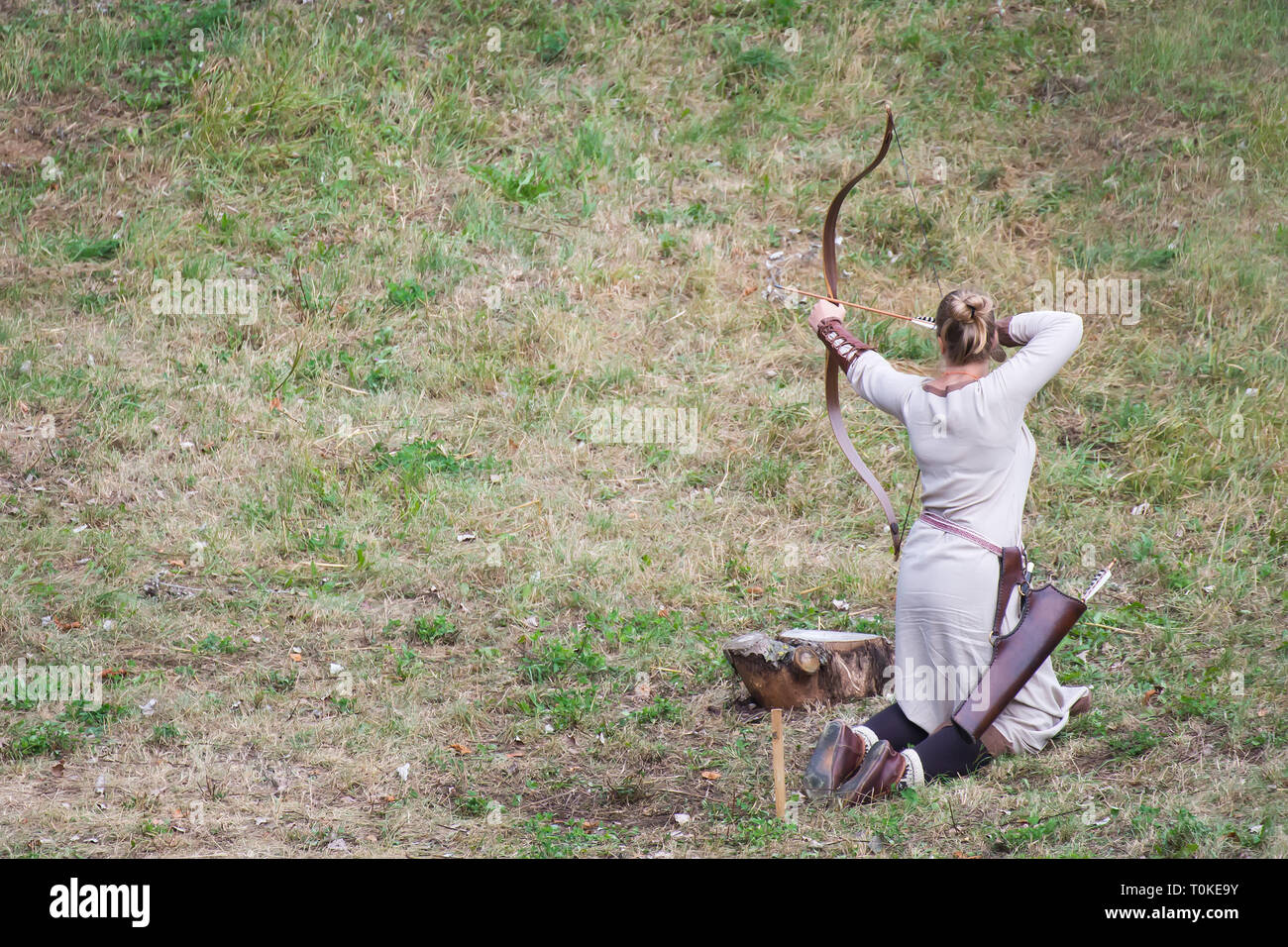 Slavic archer female aiming the target - Stock Image