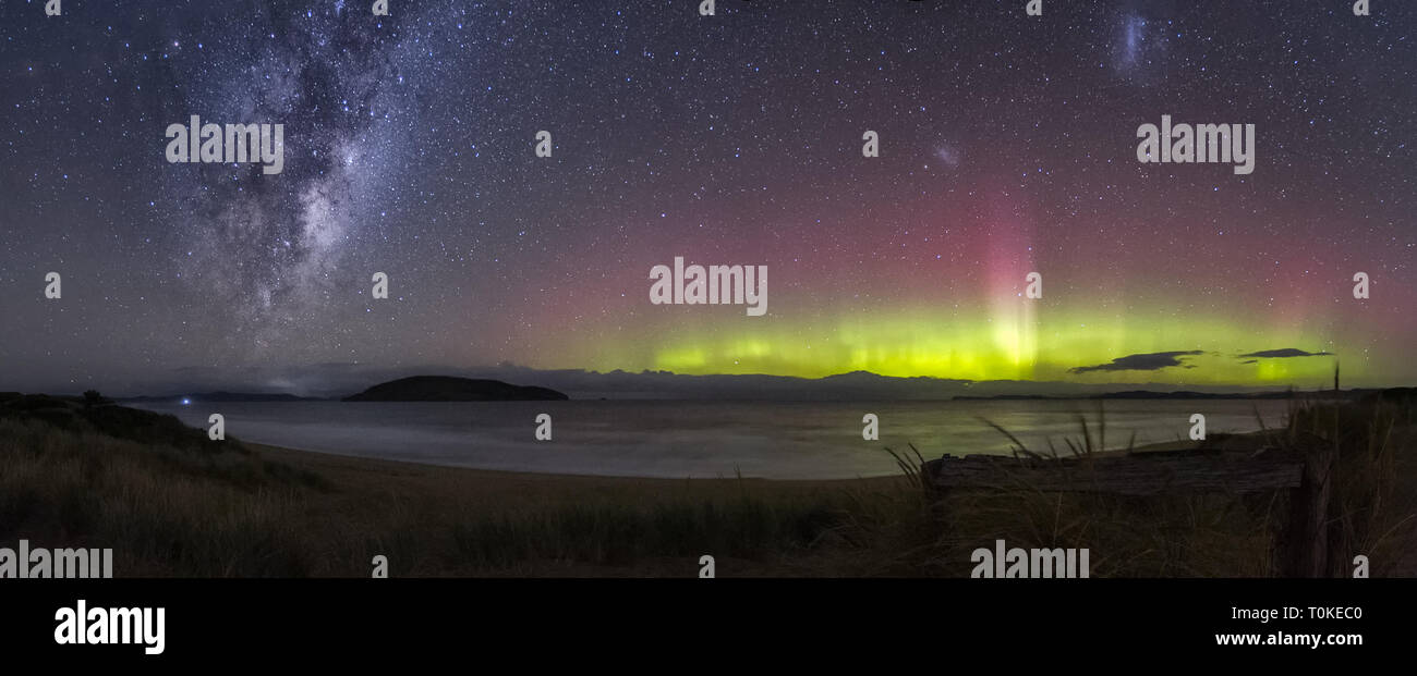 Spectacular display of the Aurora Australis or Southern Lights and the Milky Way - Stock Image