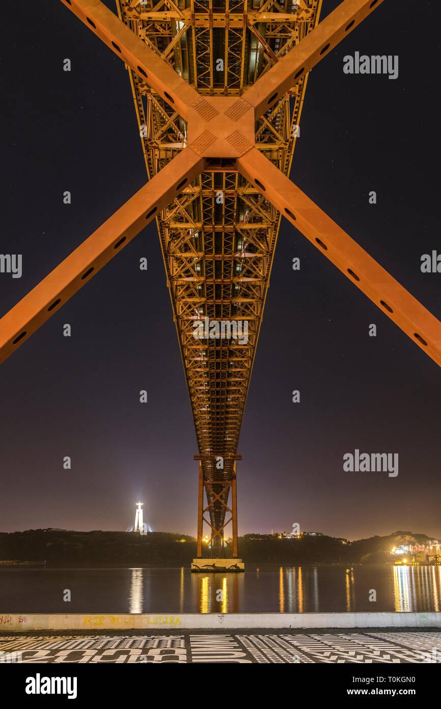 Ponte 25 de Abril in Lisbon, Cristo Rei statue, sunset, Portugal Stock Photo